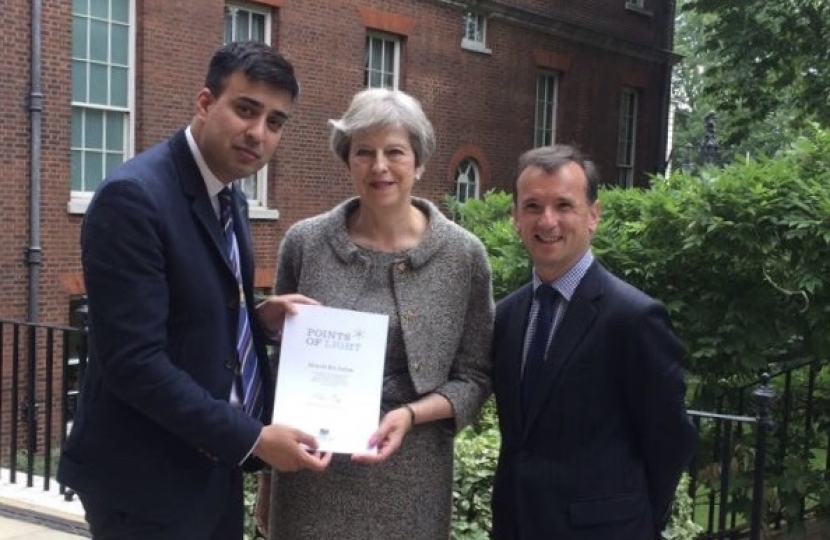 Alun Cairns MP with Moawia and the Prime Minister